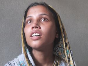 Lily, mother of Zunayed, a nine-month old infant. Lily's husband was died in the Rana Plaza collapse last year