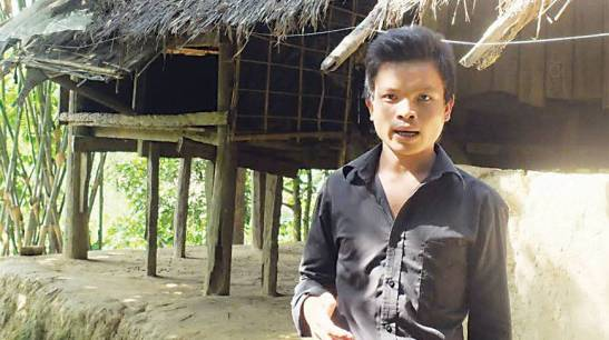 Mongkhain Chakma, in front of the house he sold to pay ransom, tells how his brothers and maternal uncle died in a Thai trafficking camp. Photo- Abid Azad
